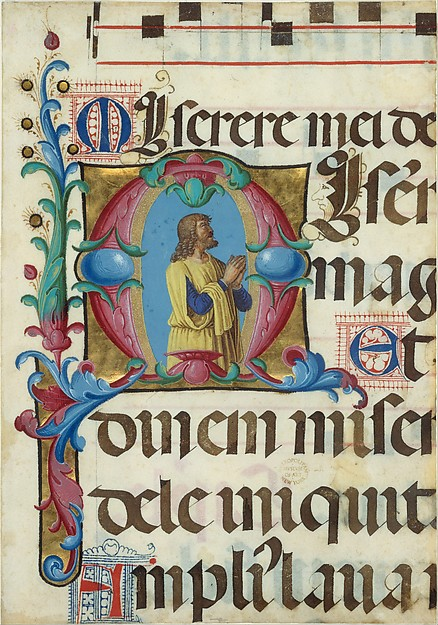 "Photo: Manuscript Illumination with David in Prayer in an Initial M, from a Psalter Artist: Girolamo dai Libri (Italian, Verona 1474–1555 Verona), Date: 1501–2. ""Like the singing monks in Girolamo dai Libri's miniature executed for the same psalter (displayed nearby), David appears here in prayer with his mouth open and his gaze turned heavenward. In many images of David, God the Father appears above him as the object of his inspiration. Like the monks, he appears to look beyond the frame of the initial, as if he were reading the text of the psalter.""  To learn more about this piece, see: The Metropolitan Museum of Art"