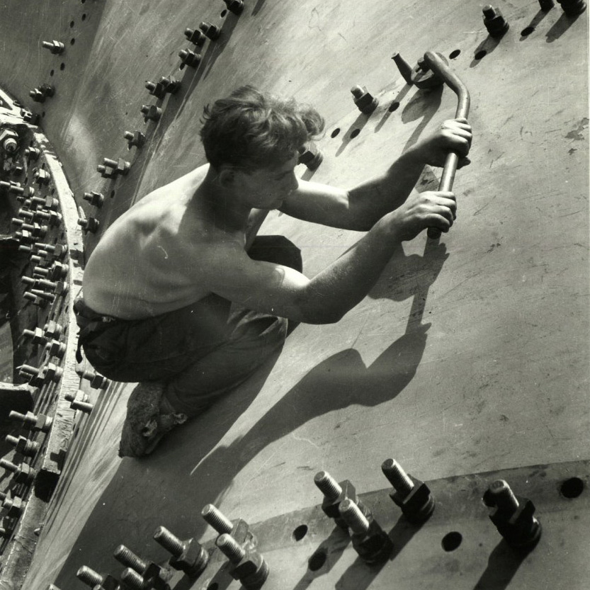Tightening bolts to permanent riveting on one of the water distributors of the Dnieper Dam,  1931  |  Margaret Bourke-White—The  LIFE  Picture Collection/Getty Image via  TIME