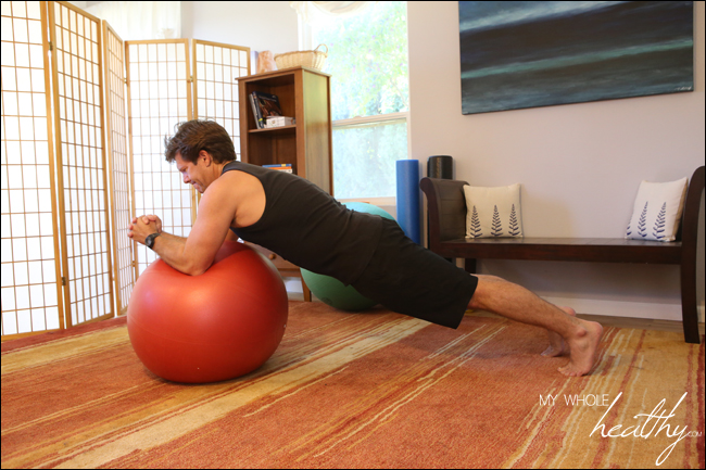As you can see, my husband is very strong and this was challenging even for him. Beyond the abdominal work of holding the plank position and extending the arms, the ball introduces instability that must be overcome as well. I would not attempt this alone unless you are certain you can do it safely.