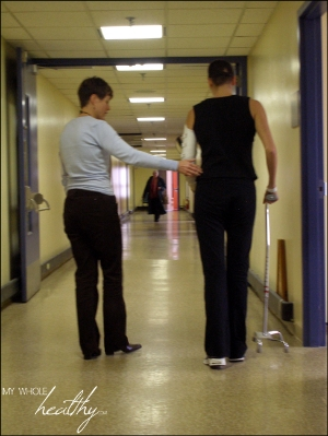 Learning to walk with a cane in the rehab hospital, my physiotherapist, Karen, guiding me.