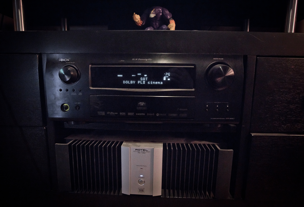 "Denon Receiver and Rotel Amp.  Also ""The Maxx"" action figure standing guard."