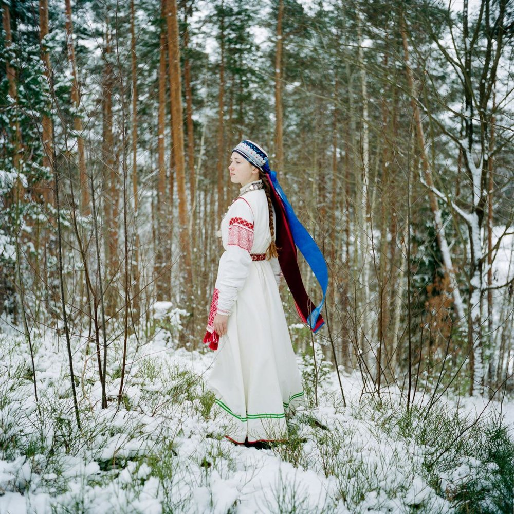 A young Seto girl wears a traditional costume in her grandparents' garden, Obinitsa, Estonia | from a favorite article this last year: A Fairytale Kingdom Faces Real-Life Troubles, National Geographic, Eva Conant (image Jérémie Jung)
