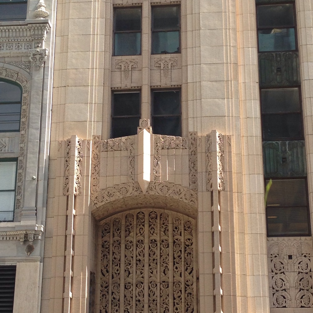 An ornate building facade in downtown Los Angeles.  The front and center detail is still simple and clean.
