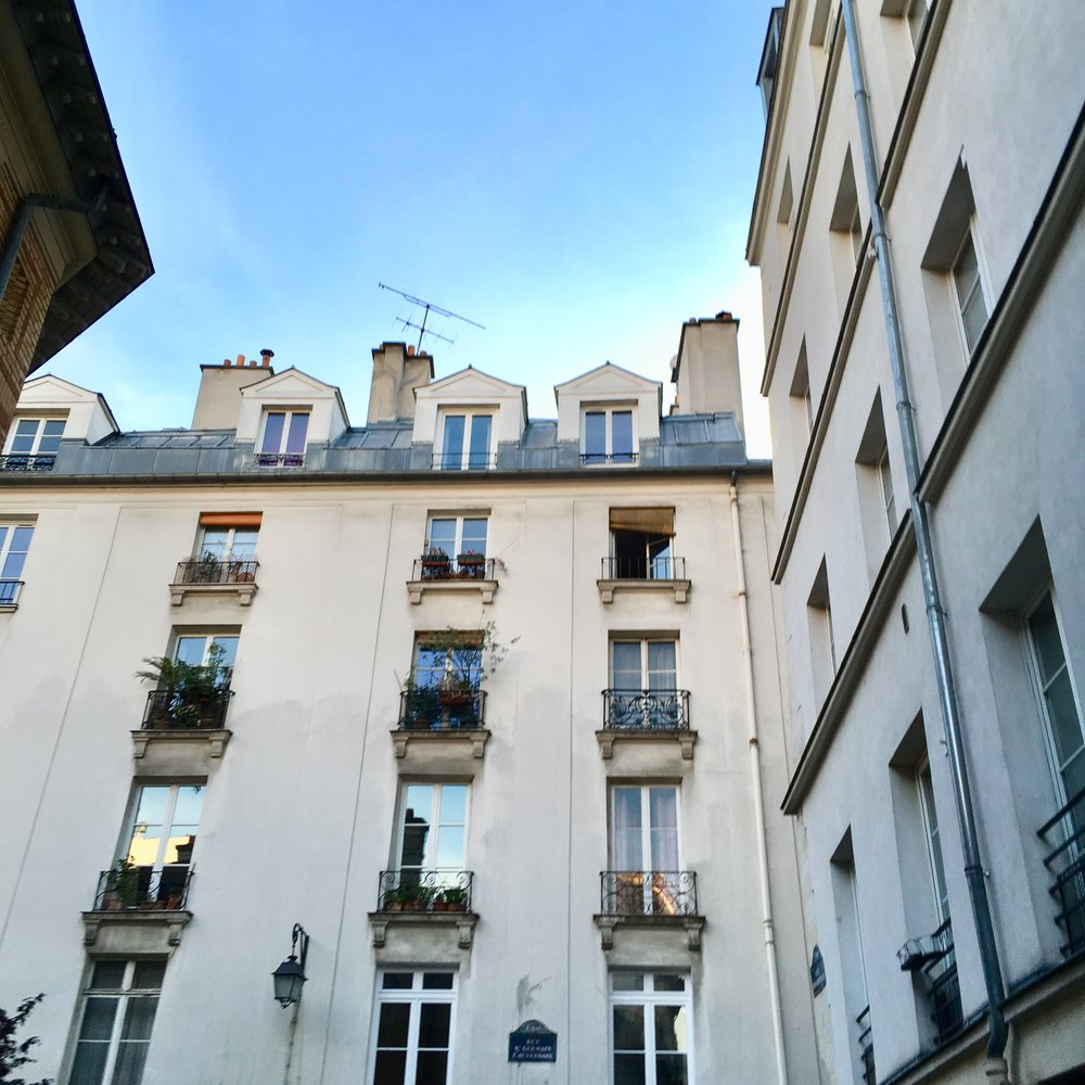 "Looking up shot from our Rue du Ofevres in the first arrondissement.  The building we stayed in was built in the 17th century and in the mid century housed the goldsmith corporation. ""Ofevres"" translates to goldsmith 👌🏼"