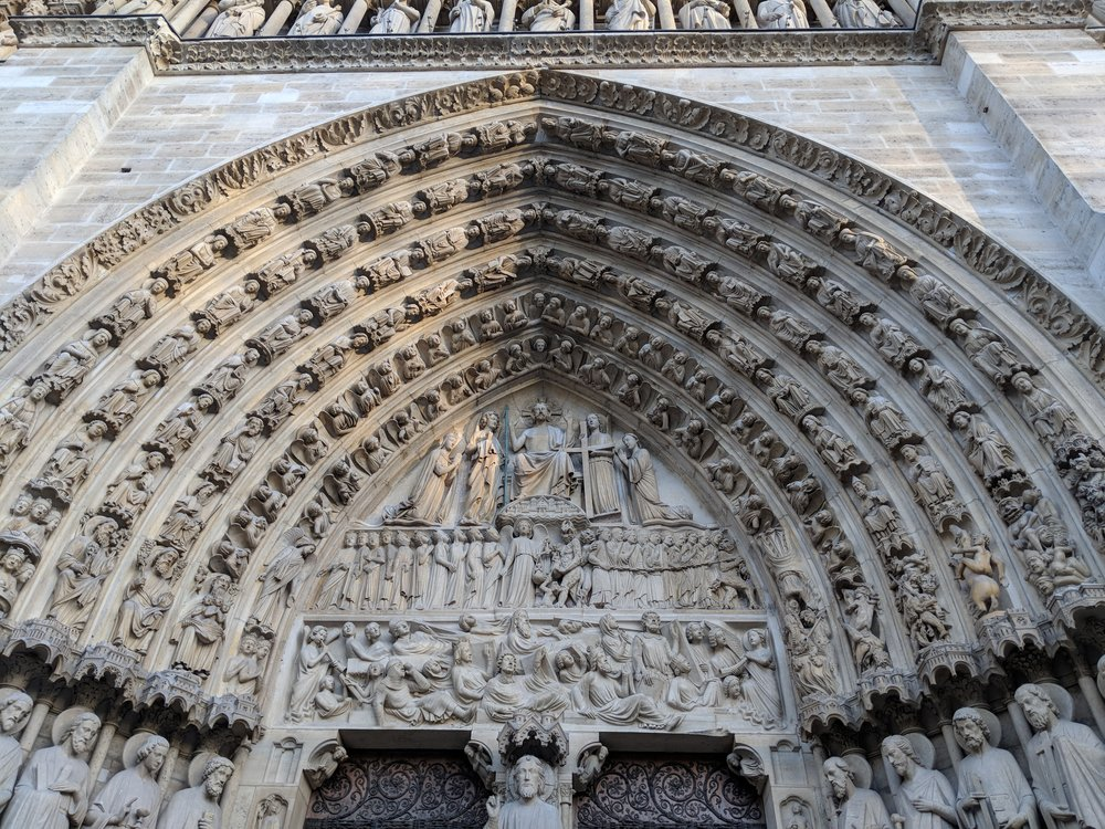 I appreciate these details because we don't take the time to make art like this anymore (due to time, cost, efficiency and whatever excuses).  France has done a great job at preserving its history and monuments.