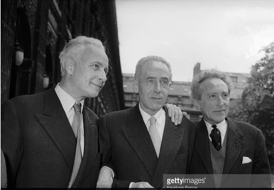 From left to right, the poet and member of the jury Louis ARAGON, prizewinner Georges LIMBOUR and the writer-poet Jean COCTEAU, who is also a member of the jury, after discerning the award of the Nuit de la Poesie to Georges LIMBOUR. June 19, 1956