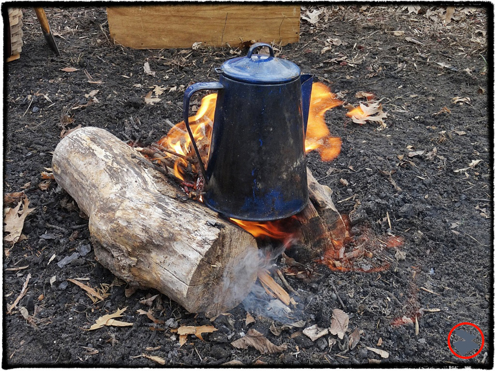 "A traditional camp coffee pot is an easy way to boil lake water--no other gadgetry needed or encouraged! You don't even need the percolator insert, which frees up valuable storage room in your pot. Here, we're using a ""Hunter's Fire."" We built a small fire between two larger chunks of wood positioned in a ""V.""  The set up works well, offering a place to sit your pot and creating a wind tunnel to direct the heat. However, don't use this set up unless you intend to burn through the larger pieces. We doused and saved the larger pieces of wood in the pit for our evening campfire."
