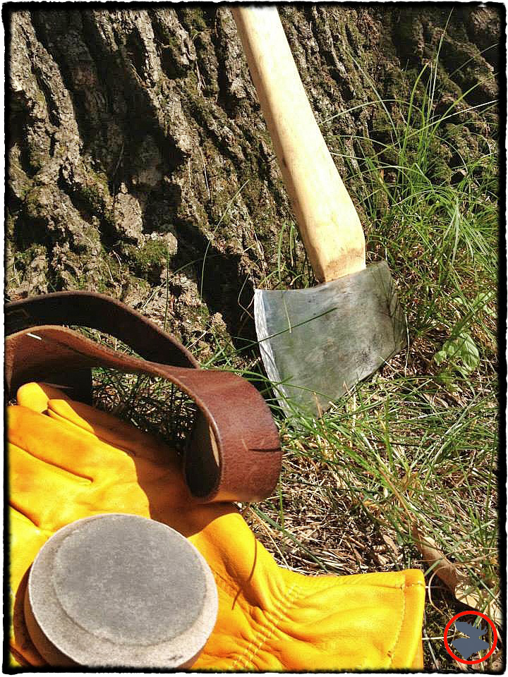 Sharpening my like-new Plumb axe with a Lansky dual-sided puck stone.