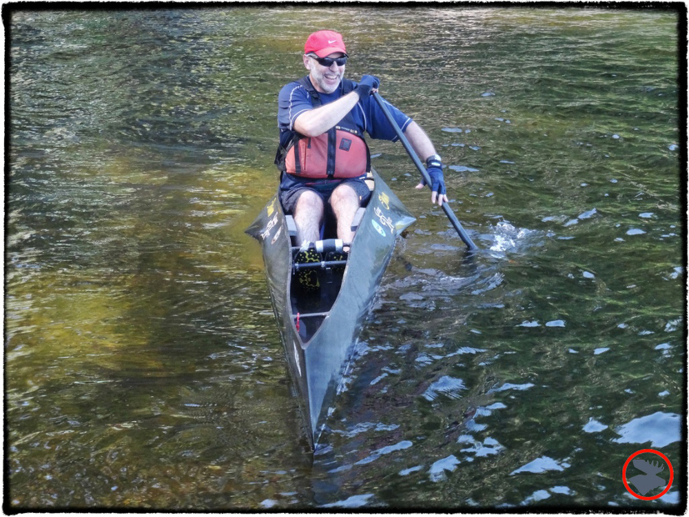 Shawn Burke cruising through the Maine Canoe Symposium waterfront.