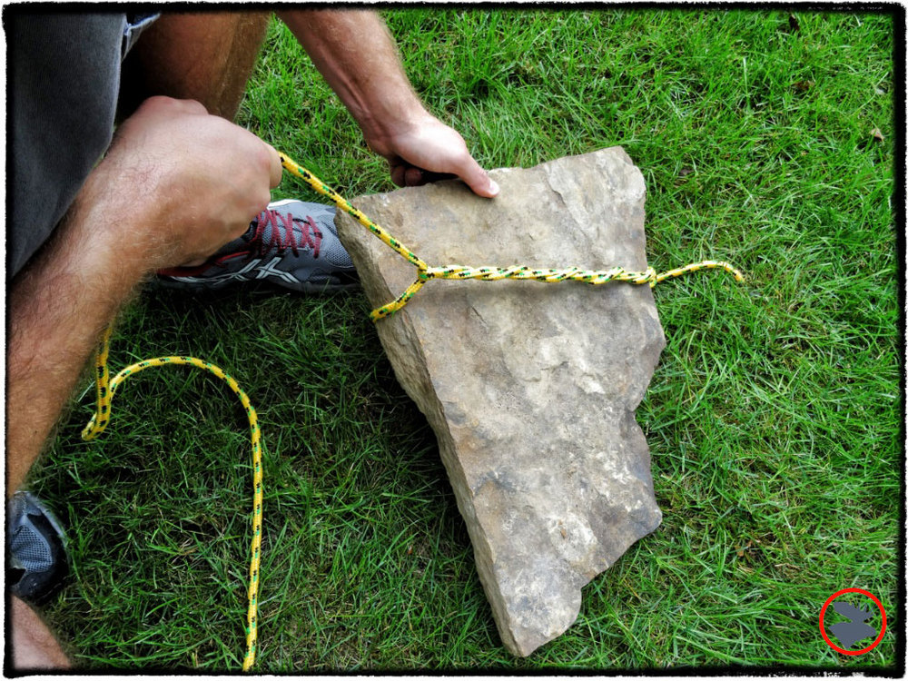 Begin with a regular Timber Hitch.  Include enough wraps to allow for a friction bite.