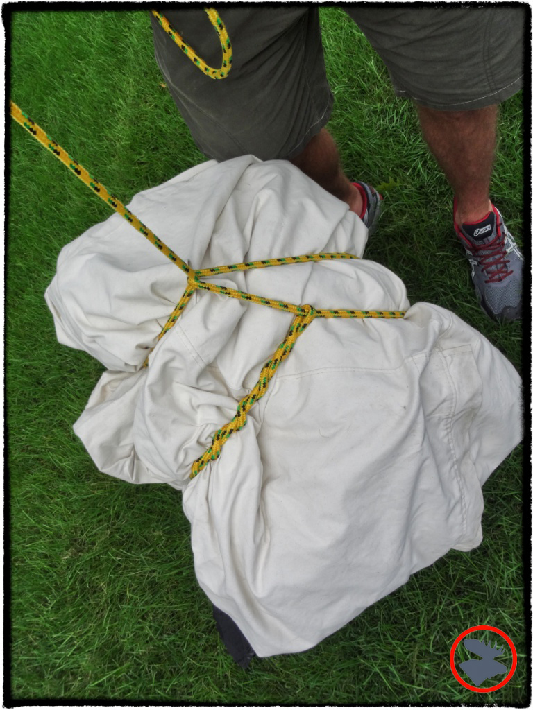 Carrying the Snowtrekker tent using a Killick Hitch--a slightly advanced version of the Timber Hitch.