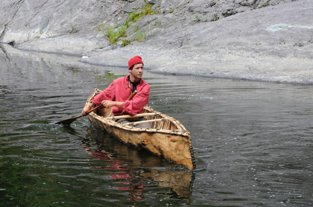 Billy canoeing in a bark canoe, similar to what early woodsmen used. Photo credit: www.BillyRioux.com