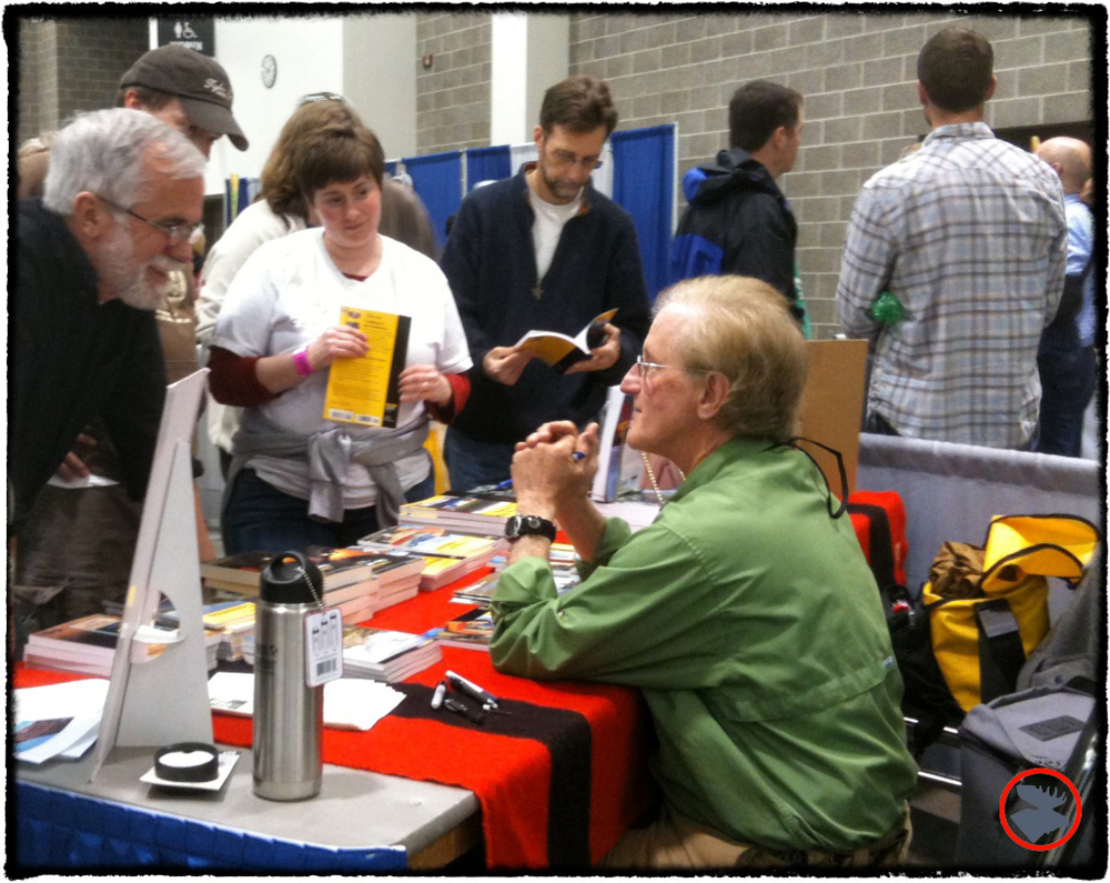Cliff Jacobson talking with Canoecopia attendees.
