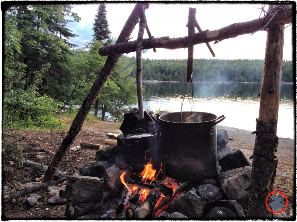 We constructed a fire tripod rig and carved pot hooks out of dead wood to boil water and cook our meals.