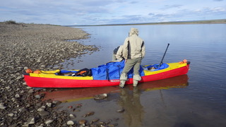 Packing a canoe on the Colville.  Photo courtesy of Bob O'Hara.