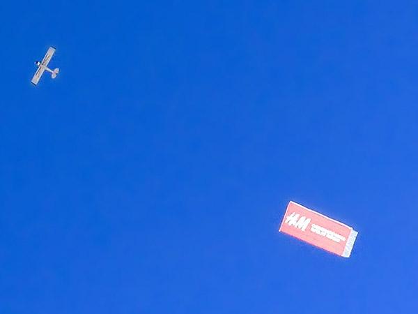 Aircraft banner advertising.