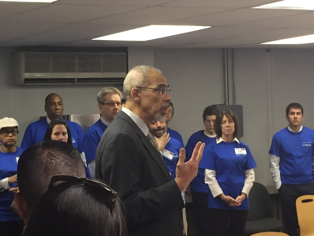 Focus Hope  CEO William F. Jones addresses Chase Bank employees visiting the distribution center.