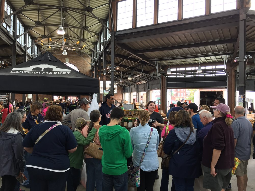 Eastern Market_Inside_Jeanette Talking To Tour Group 2.JPG
