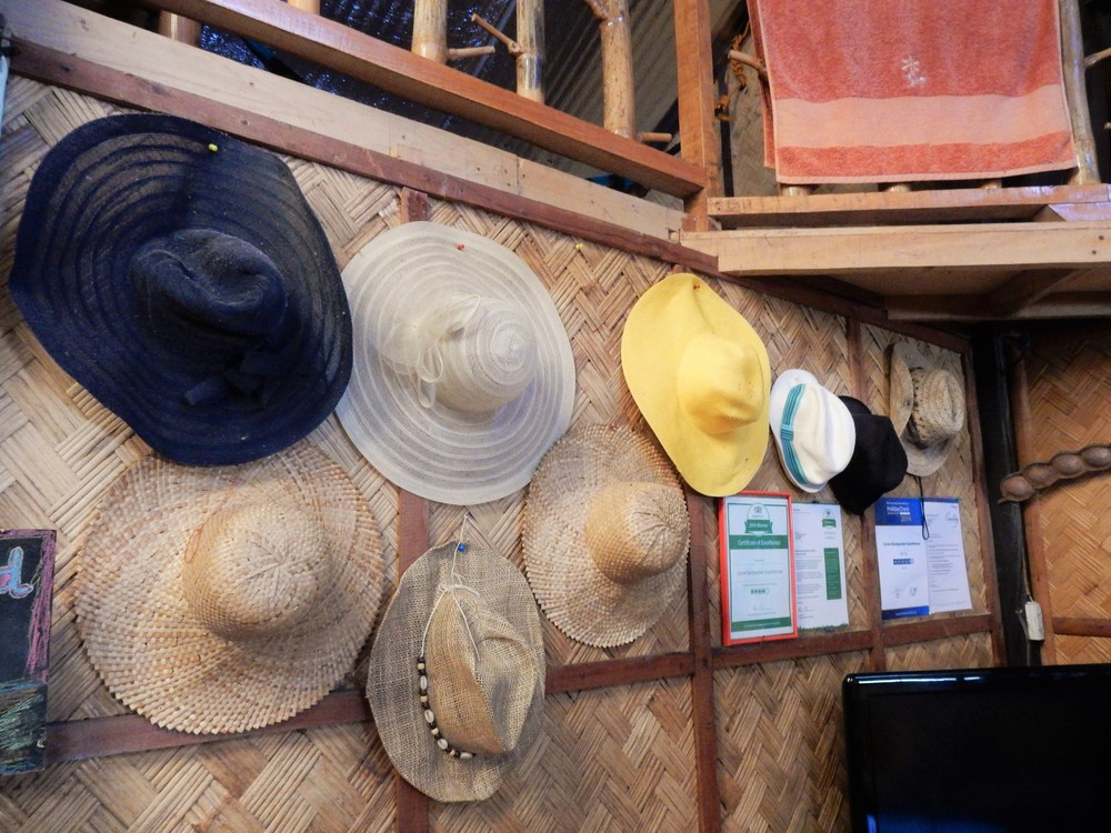Coron Backpacker Guesthouse hats left by travelers