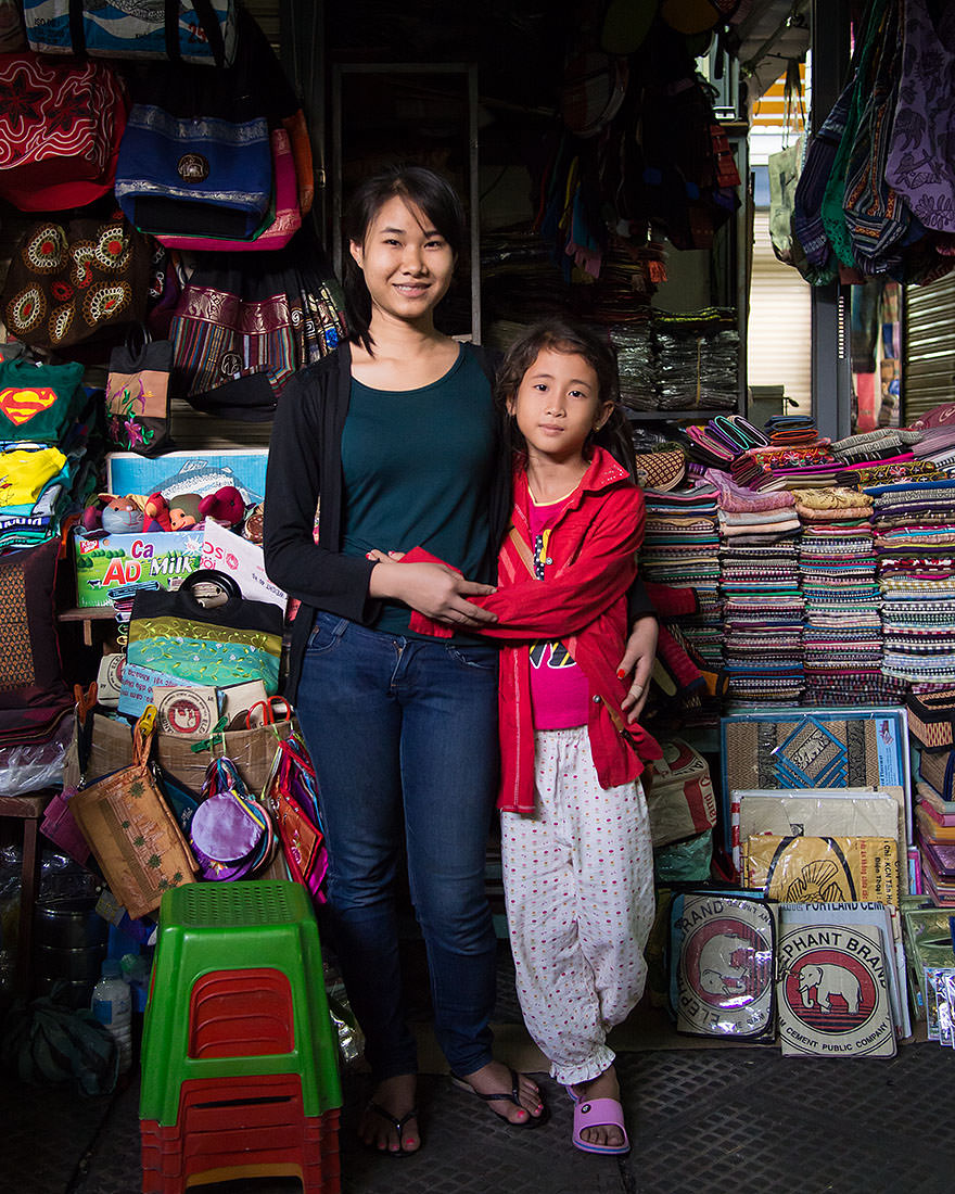 """I don't have time to play. I have to work all the time.""   ""What would you like to do in the future?""   ""I would like to go back home to live with my mother.""  — Liya, with younger sister, Nita (Phnom Penh, Cambodia)"