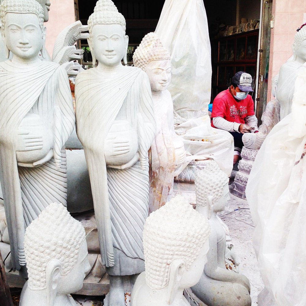 A worker craft statues at a shop in Phnom Penh, Cambodia