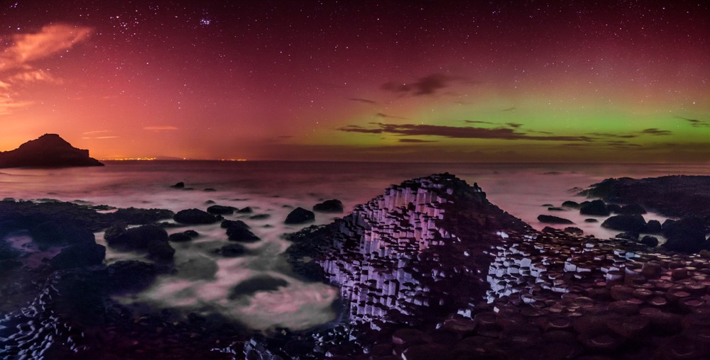 A four vertical-shot stitched panoramic of the aurora at the Giant's Causeway.