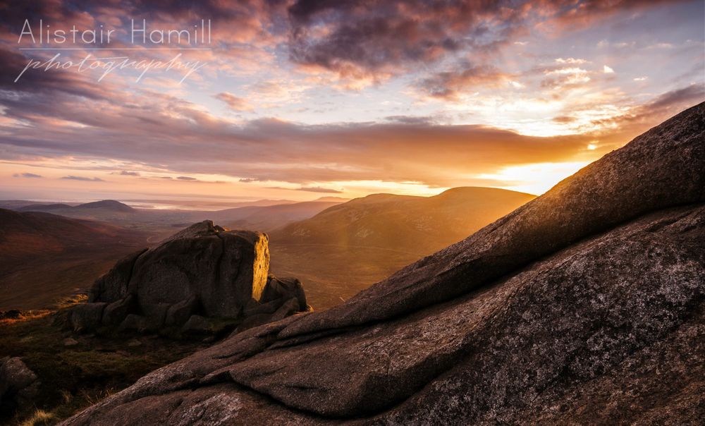 One of the granite boulders on the summit of Doan is painted by the warmth of the setting sun