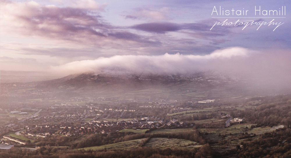 The view towards Divis and Black Mountain, draped in their own cloud, with a fine mist sweeping in from the west