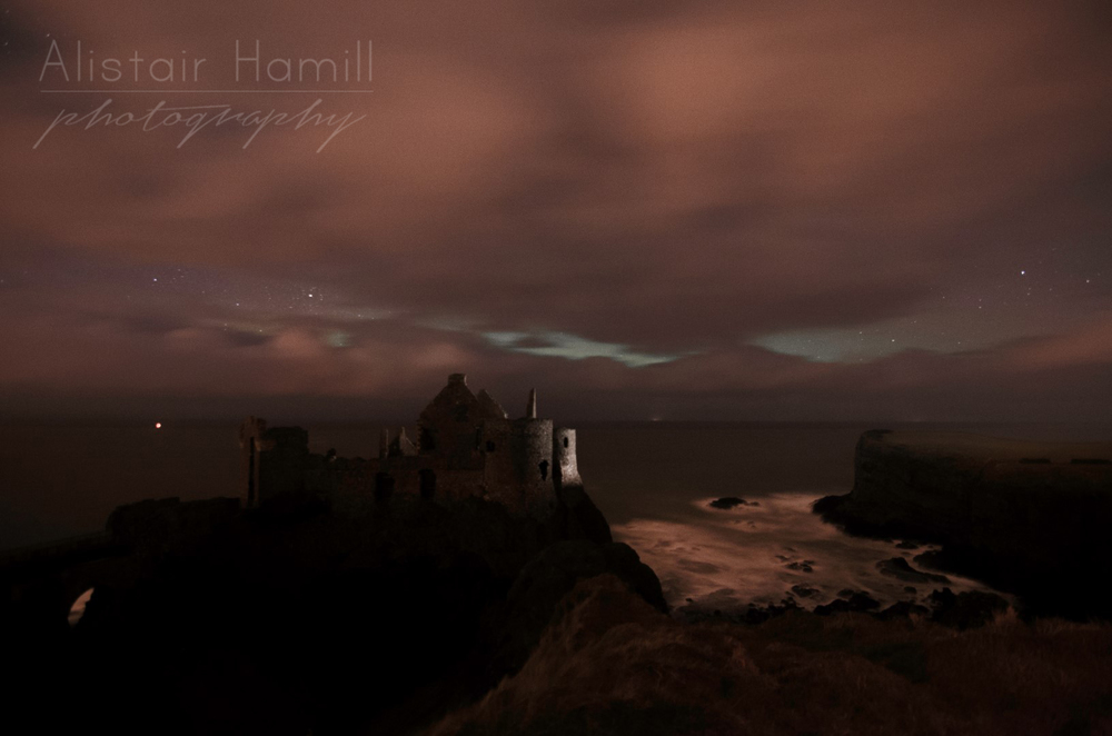The scene closer to what it looks like with the naked eye. The lighter portions running horizontally are not lighter cloud in front of the cloud banks, but breaks in the cloud with the tell tale whitish glow of an aurora being revealed behind.