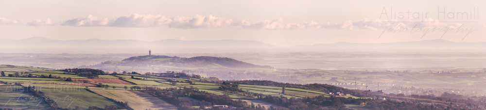 The Country of Down, draped with a light mist, as seen from the top of Cavehill