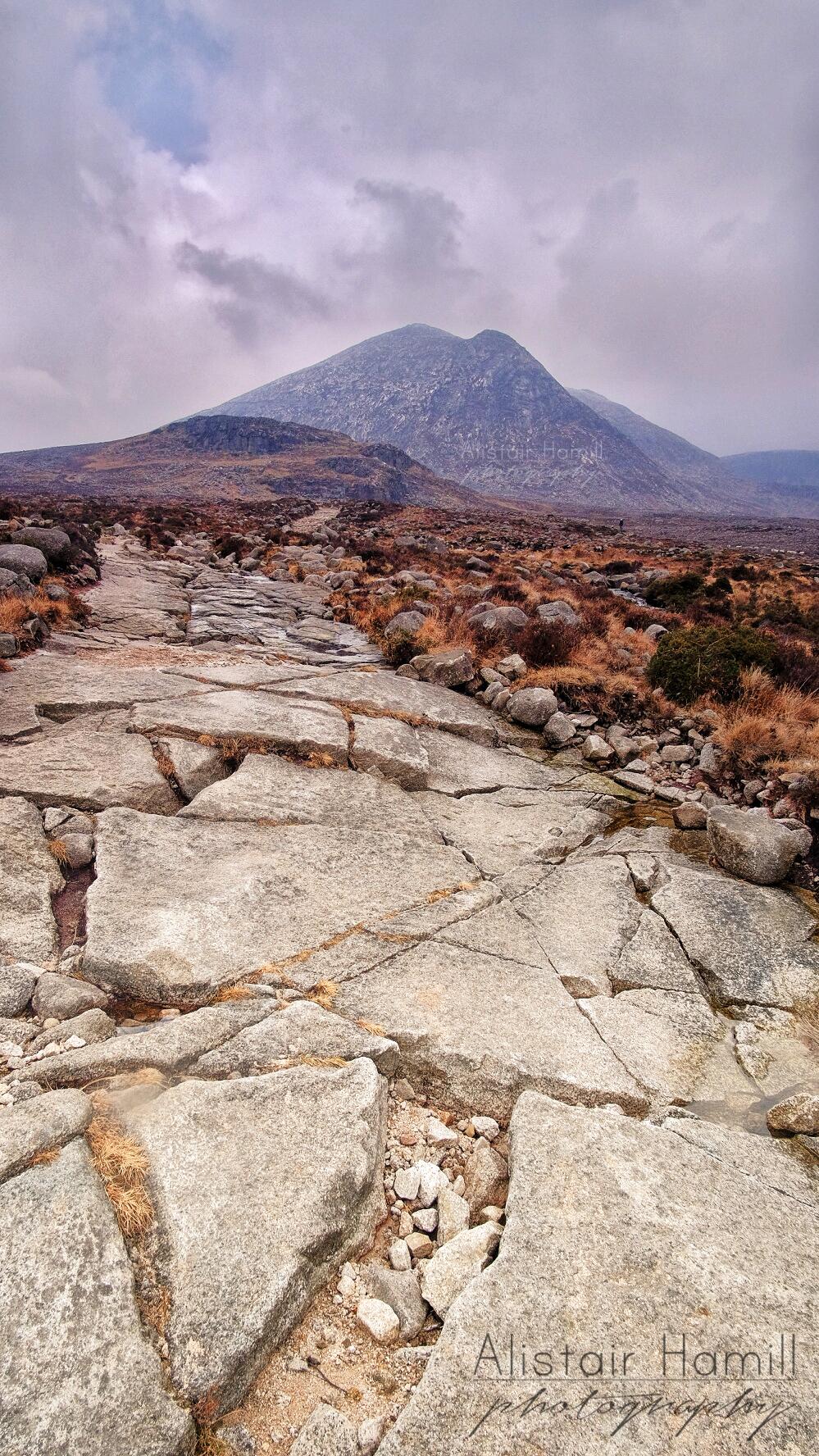 Granite slabs mark the path to Lamagan.