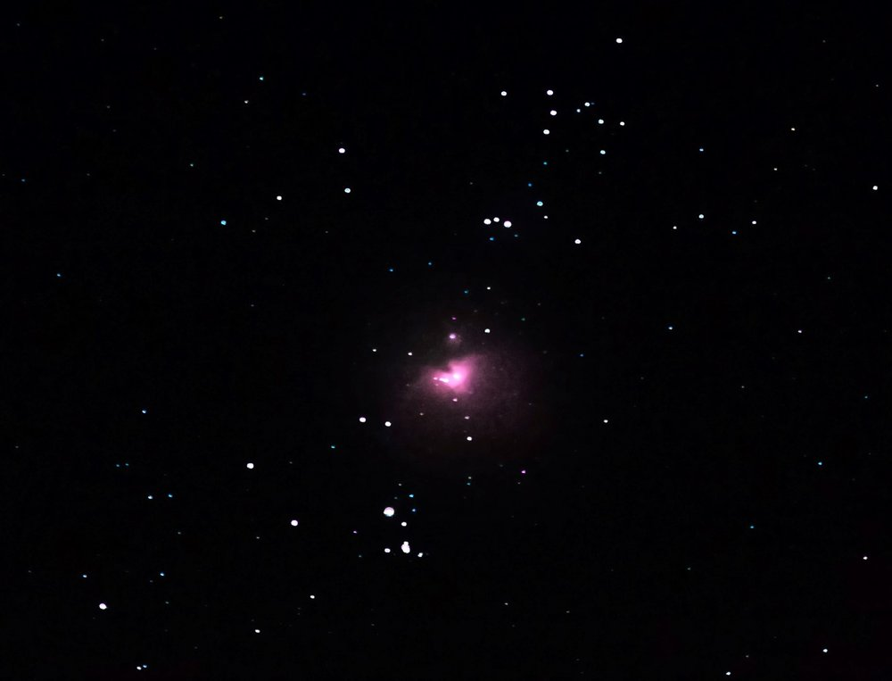 Is it a star? No, it's Orion's Nebula - captured by nothing more than a 200 mm zoom lens!
