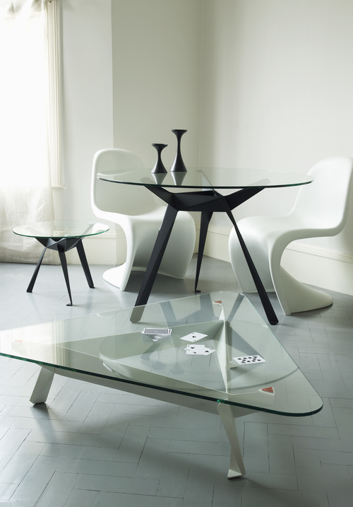 The inspiration for the Origami table came from African hand-carved tripod tables. The aim was to create a contemporary, industrially produced version in a more efficient way.