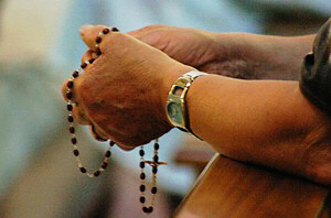 hands praying rosary 7 as m2