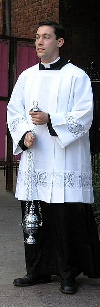 195px-Priest_or_seminarian_with_censor
