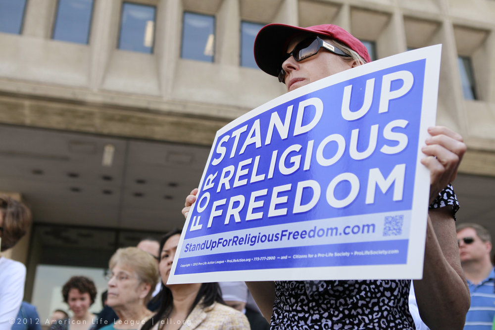 Demonstrator at a Stand Up for Religious Freedom Rally. (American Life League/Flickr)