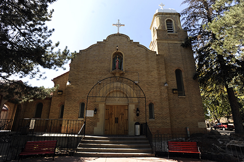 This is the facade of Our Lady of Guadalupe Church at 1209 W. 36th ave in Denver, The mural that has been covered up was painted by Carlotta Espinoza and hung on the back wall behind the pulpit.  The Archidioces built a wall to cover the large mural of vigin of Guadalupe and Saint Juan Diego.  People  protested but their protests went much ignored so people have sent a letter to the archobishop which has been  signed by 435 community members.  Their hope is to get the mural back out for all to see and is fully restored.