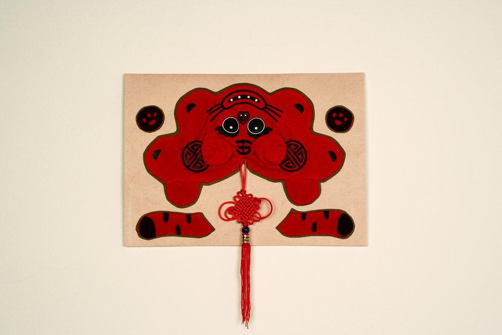 Catherine Davis   Year of the Tiger Skin Rug   cardboard, paper, thread, tassel and stuffed animal pelt  2010