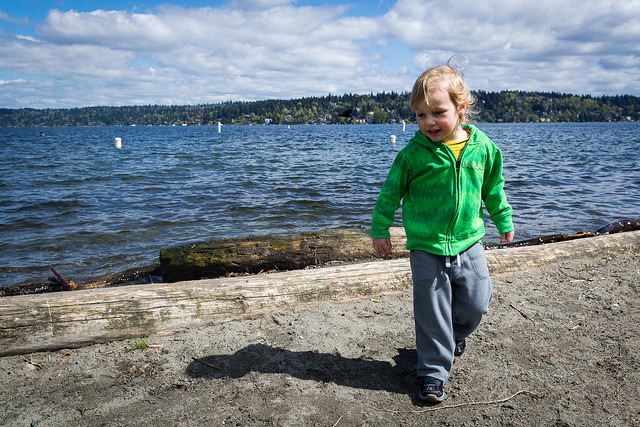 The Boy having fun on the beach with Lake Washington behind him.