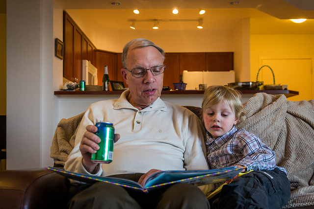 The Boy does love story time. (For the picture I should have made my Dad put the can of pop away.)