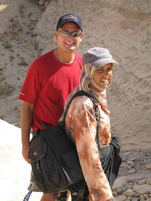 Mark with Saba carrying his camera bag
