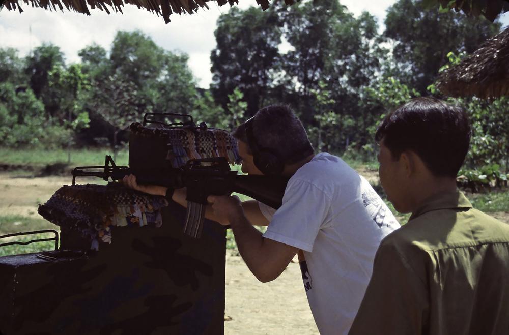 Cliff firing a Vietnam era weapon at the shooting range at the War Memorial Park