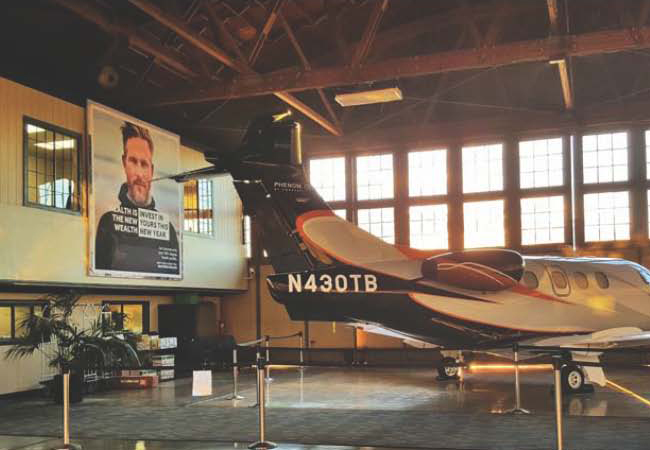 Billboards inside private jet hangars…