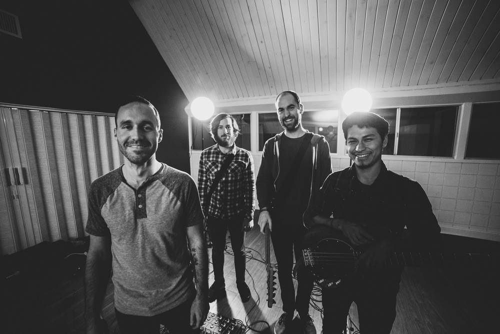 From left to right: Elijah Kellogg (lead singer), Daniel Griffin (Guitar & Sound Engineering), Daniel King (Guitar & Video Production), Josh Marmol (Bass)