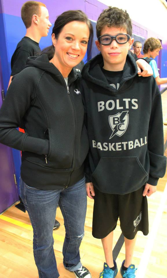 Parker with my sister-in-law, Kelly, at a recent basketball tournament.