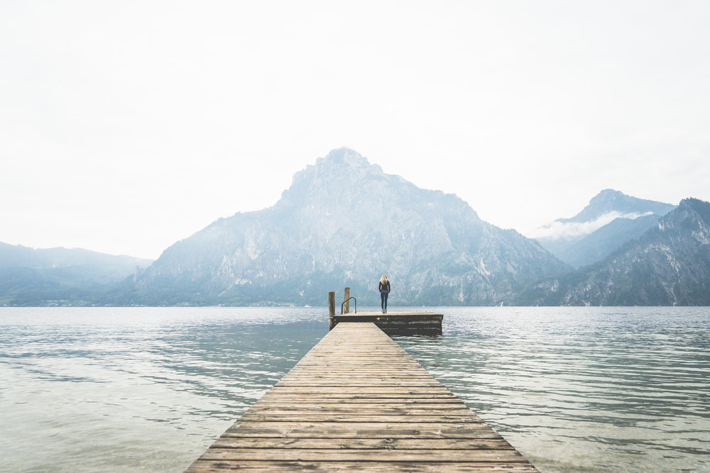 woman-standing-alone-on-a-large-wooden-pier-on-a-lake-picjumbo-com.jpg