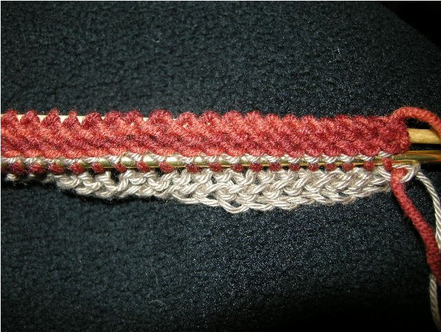 All the purl bumps are now stitches on the finer needle (below).  Original needle is still in place (top).