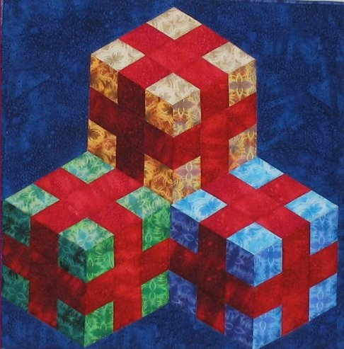 Patchwork Illusions quilt – STACKED AND WRAPPED By Karen Combs