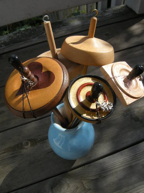 High-whorl drop spindles, clockwise from top: Ashford, Spindlewood, Spindlewood, Kundert, homemade.