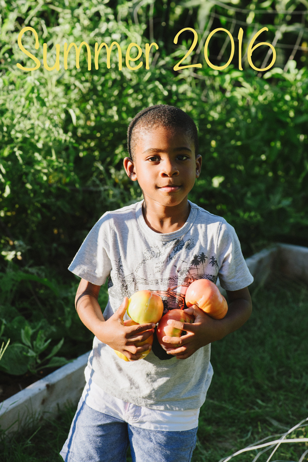 Marcus has a simple expression on his face after I told him to bring in the tomatoes from our garden.  This shot is one of my favorite out of many.  He is growing up so quickly and I have to savor little moments like this.
